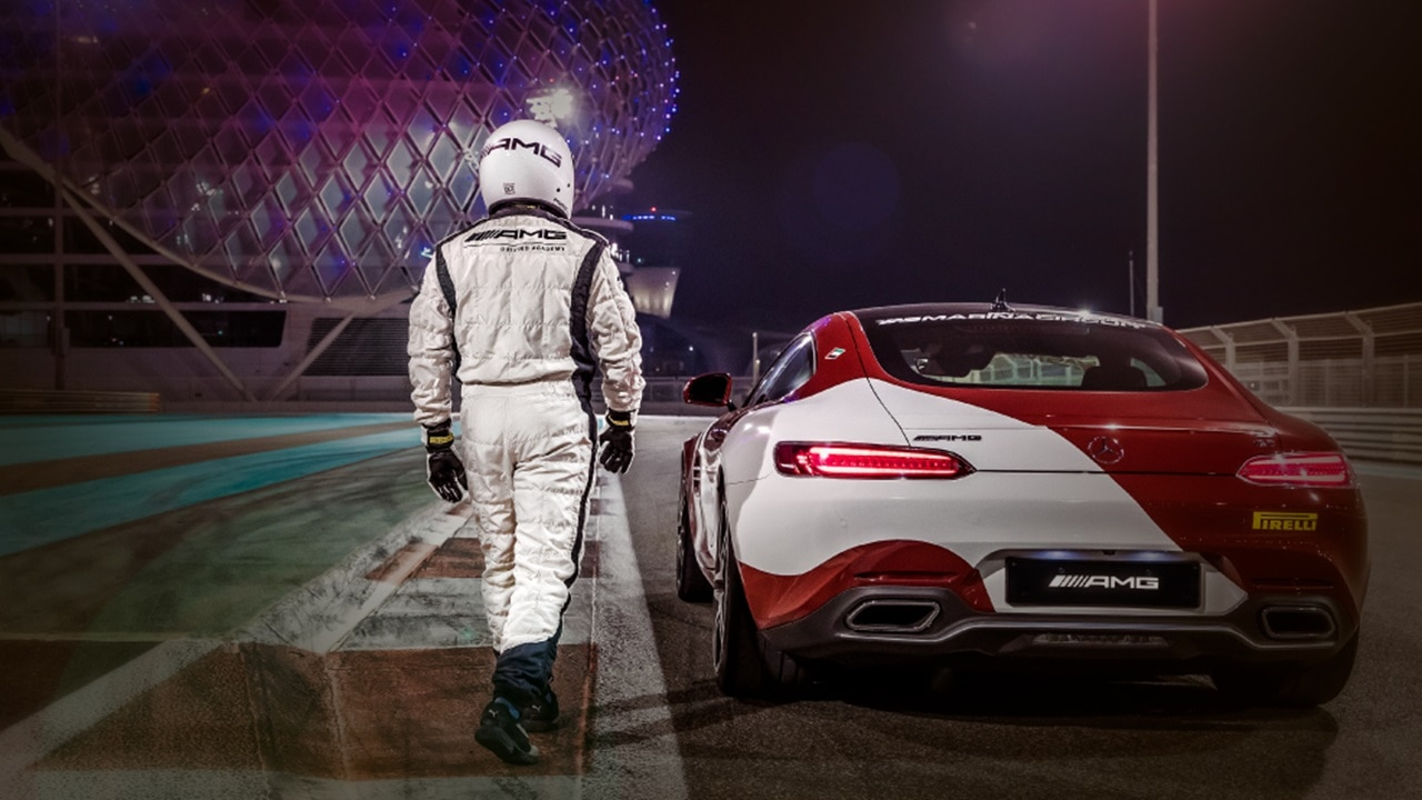 Driver walking towards Mercedes with Yas Hote
