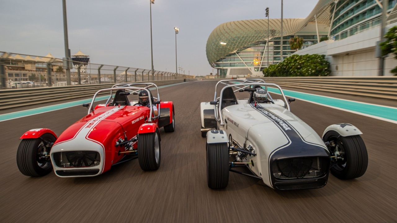 Caterham 7 go head to head on Formula 1 track