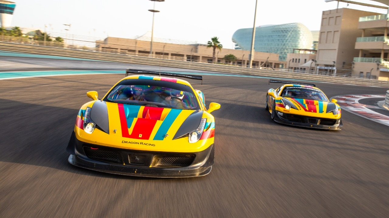 Ferraris race at Formula 1 track in Abu