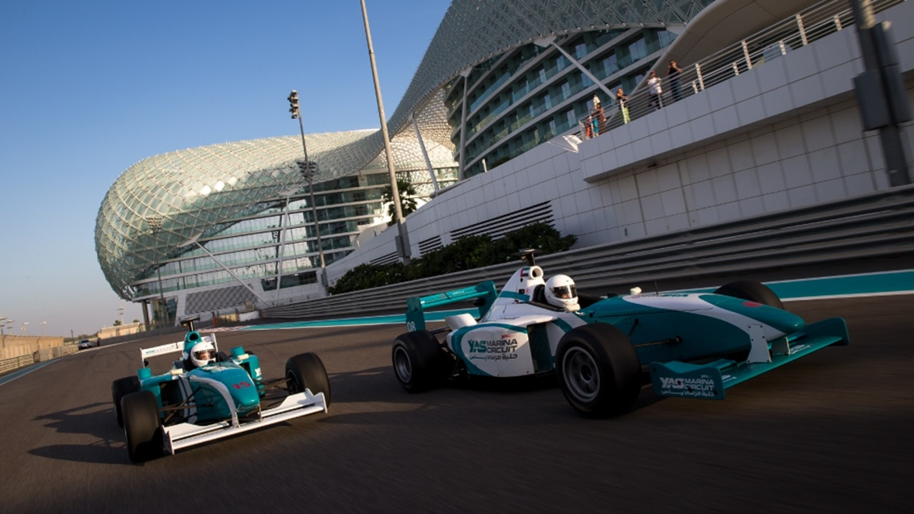 Yas Formula 3000 cars with Yas Hotel