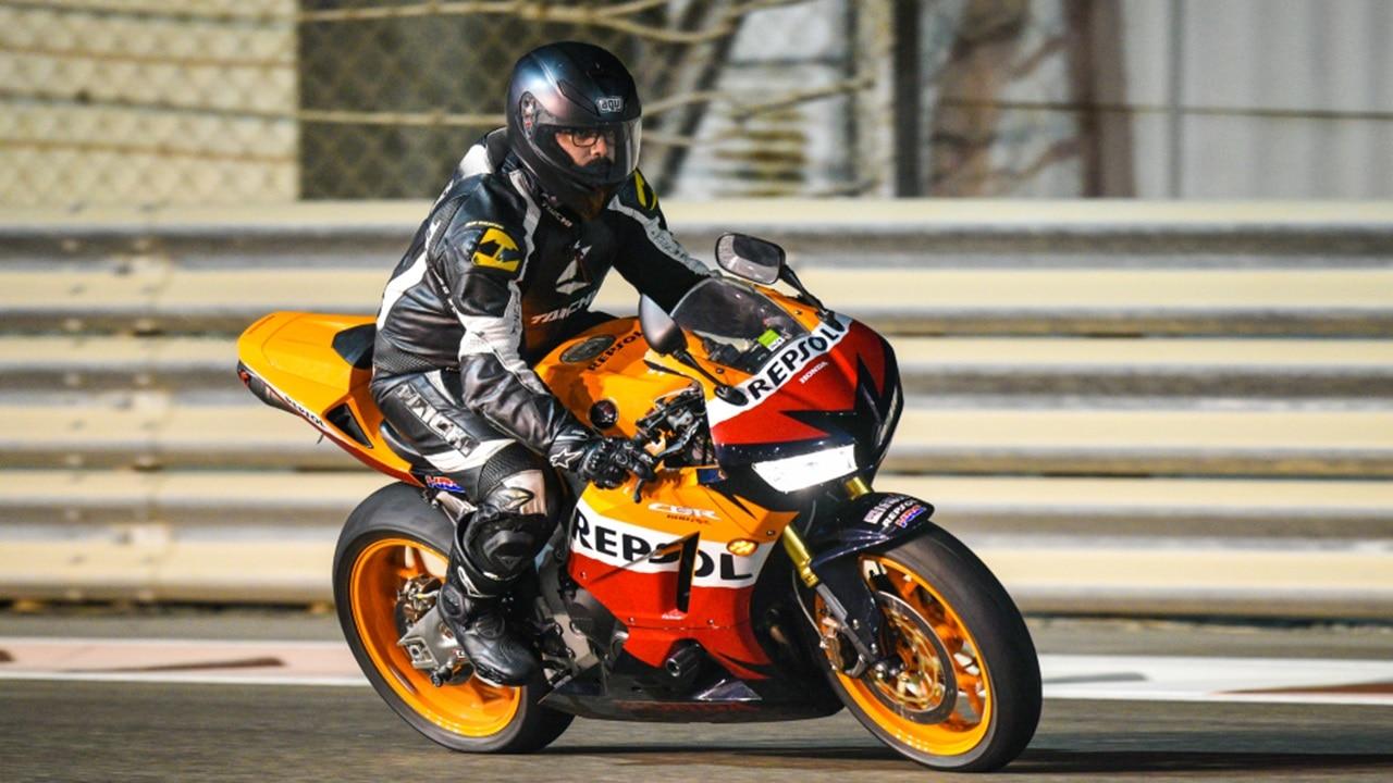 Motorbike rider on Formula 1 tr