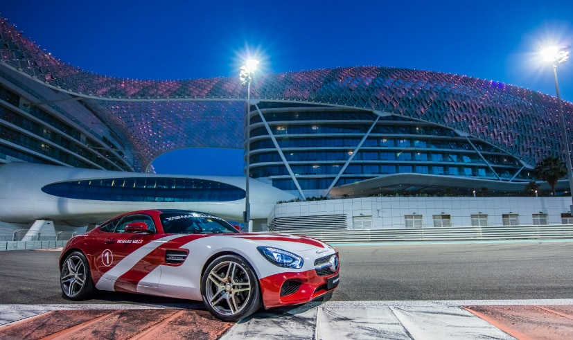 Mercedes racing car and Yas Hotel on Yas Marina Circuit