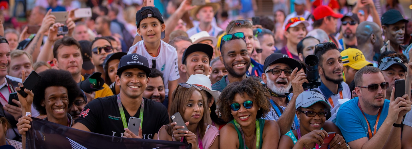 Crowds of smiling people at the F1